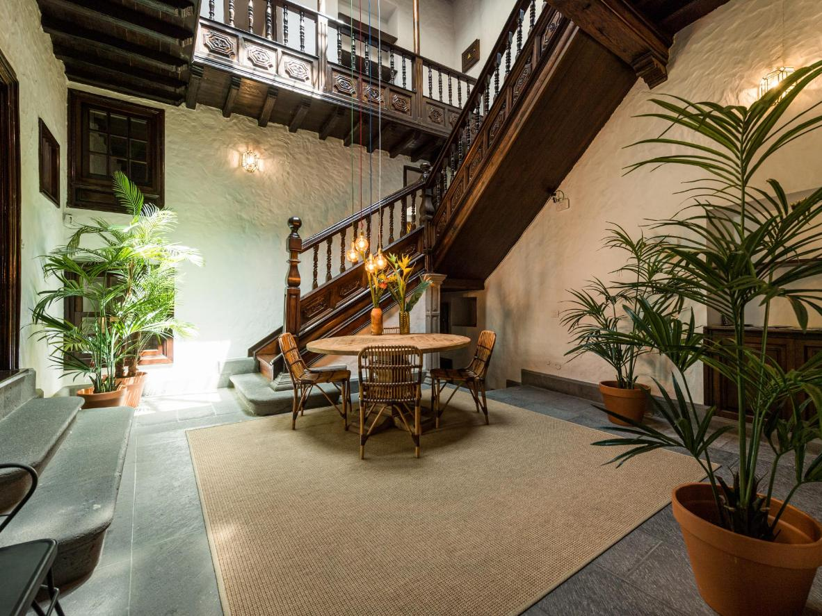 High timber beam ceilings and carved wooden doors in this historic Canary Islands villa