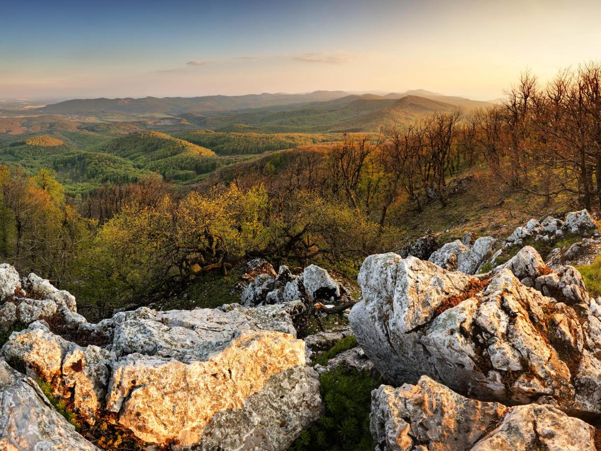 Hike through the Little Carpathian mountains past waterfalls, castles and log houses
