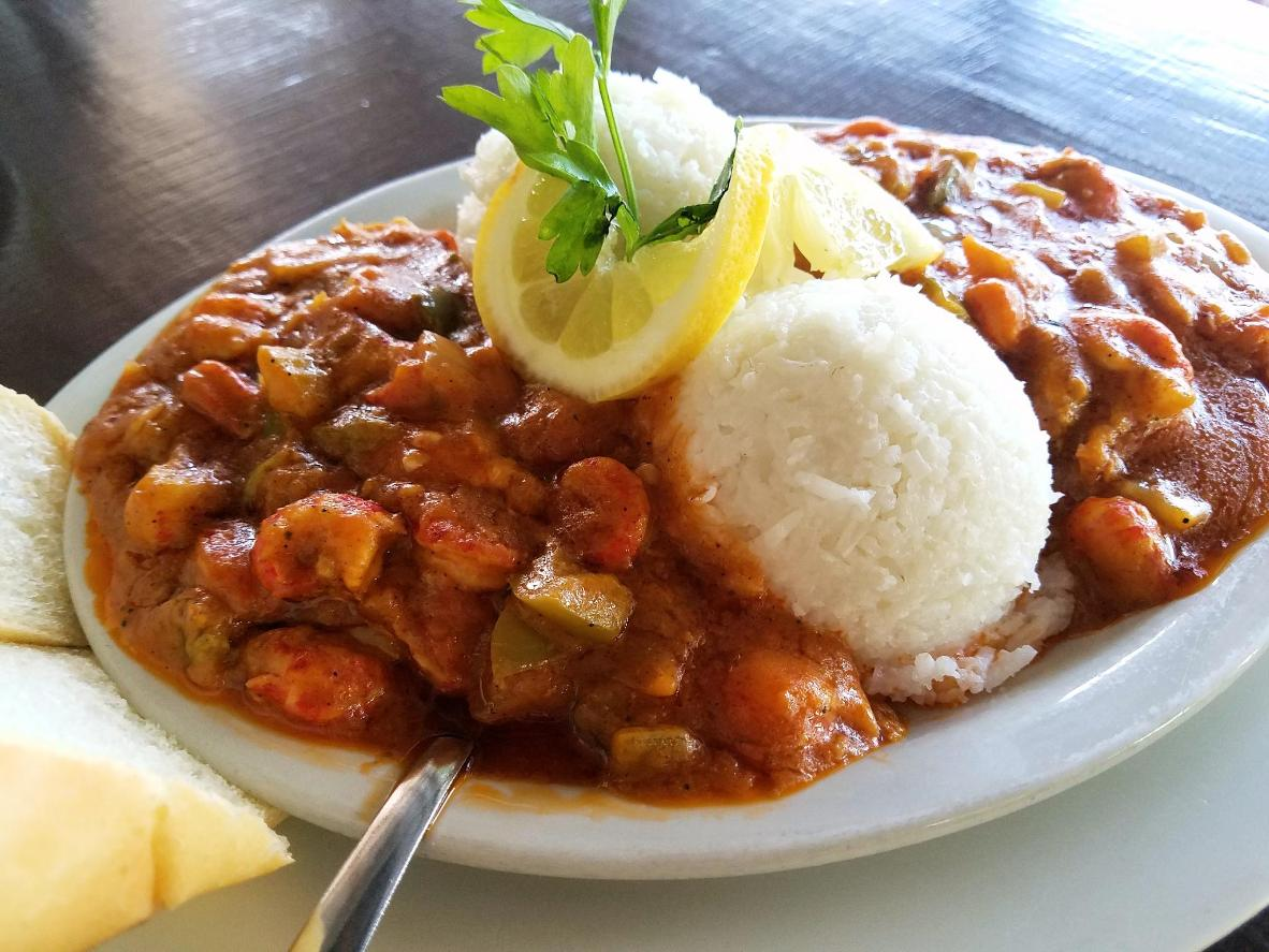 Étouffée is typically made with crawfish and served with rice