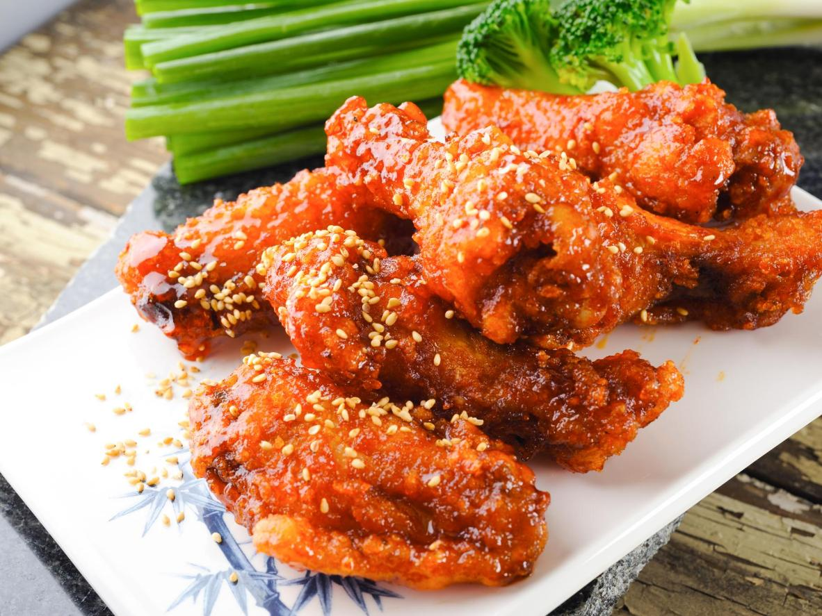 Korean fried chicken is often marinated in a dark red and spicy marinade