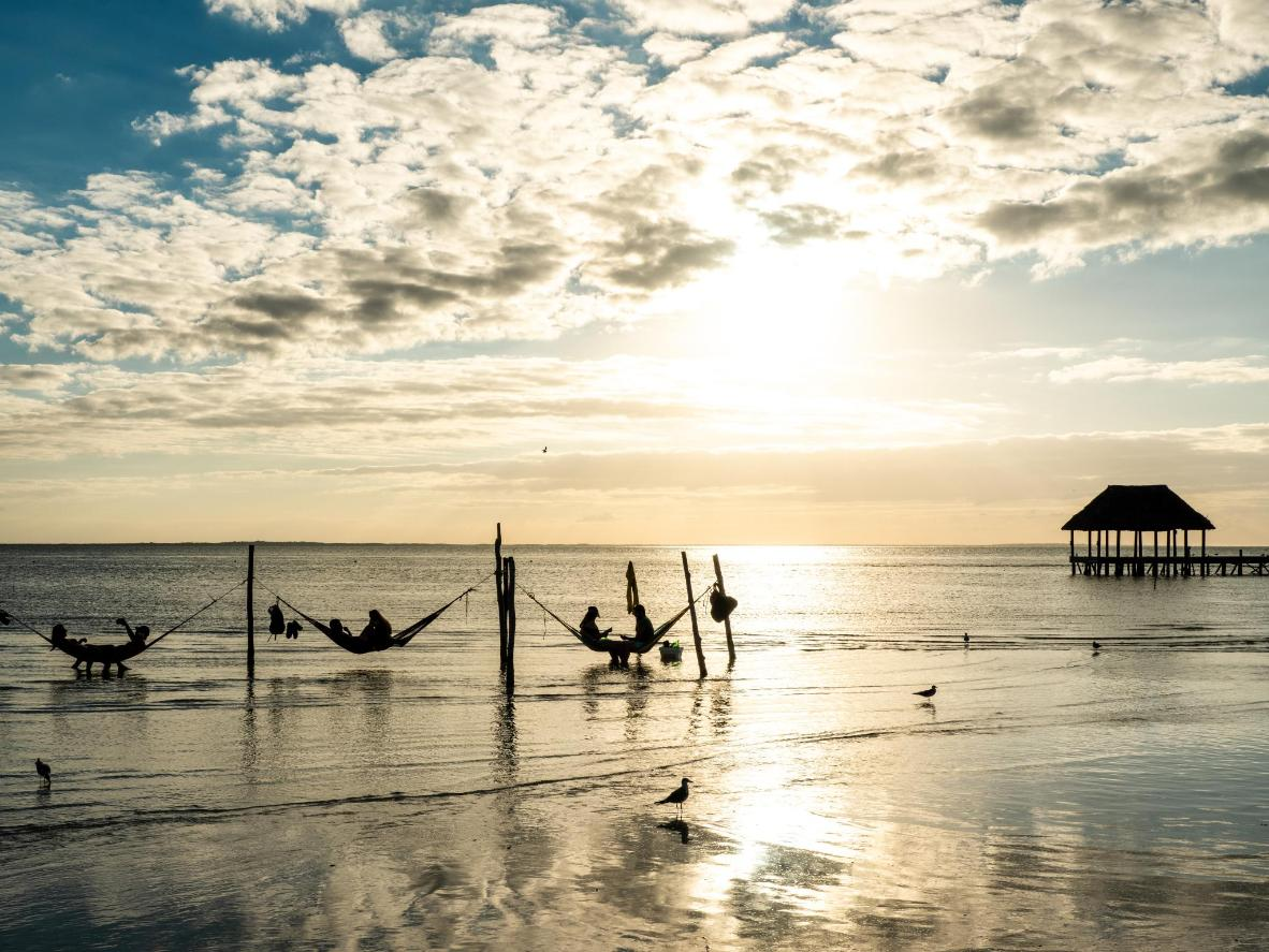 One of the most typical Isla Holbox sights is the picture of colourful hammocks lining the shore