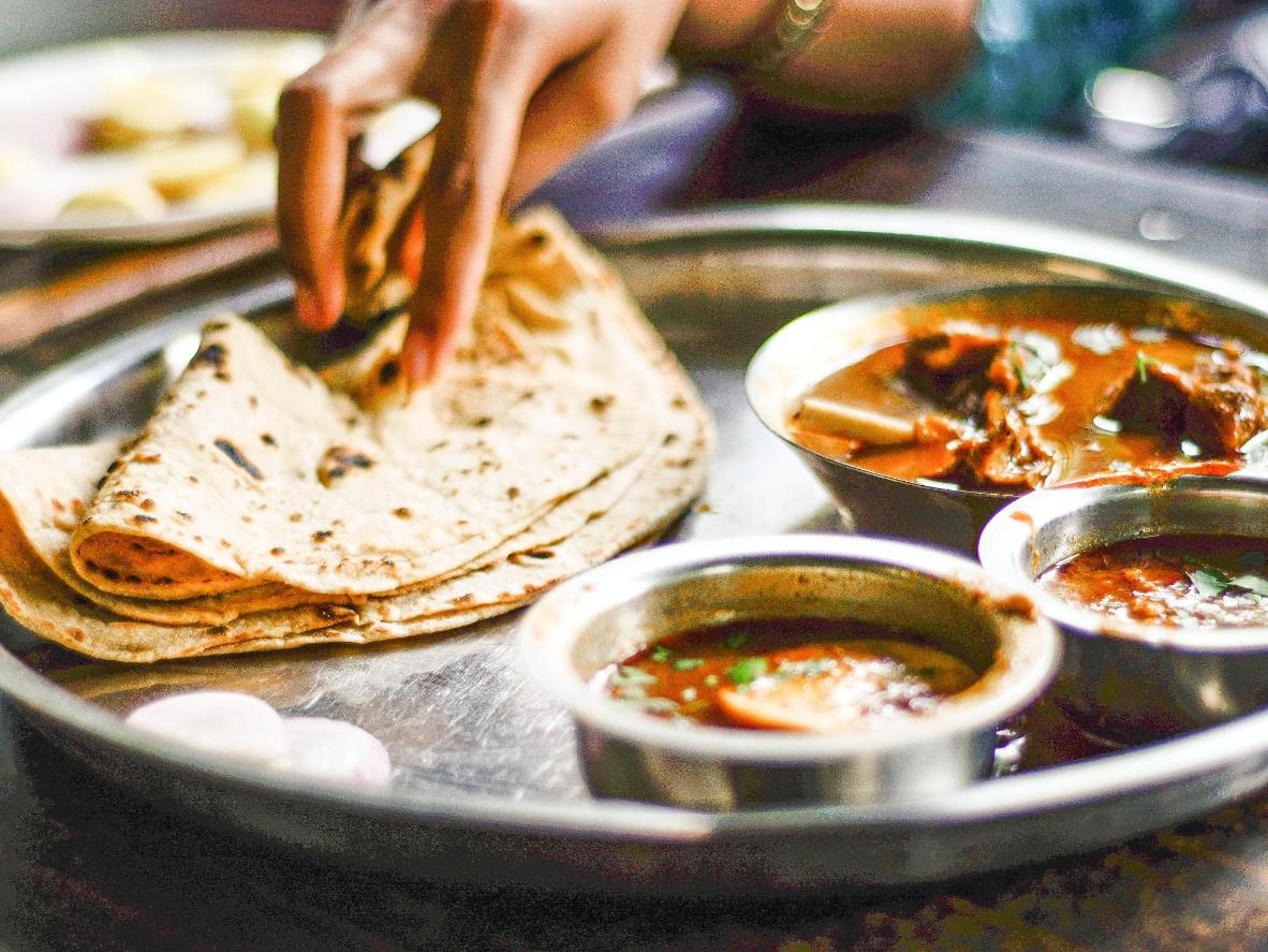 Roti is best served immediately, coated in ghee or butter