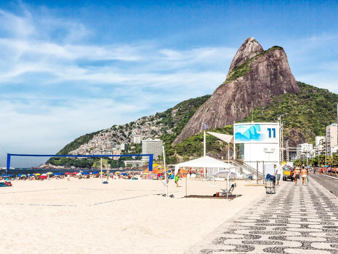 Play with both amateur and elite volleyball players in Ipanema