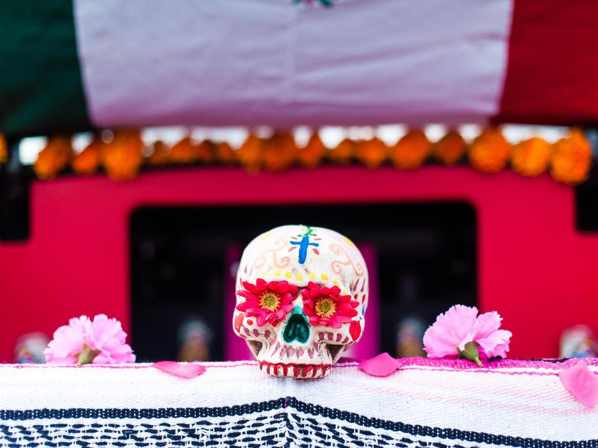 Though separate to Halloween, Día de los Muertos' painted and flower-adorned skulls make for a spooky trip
