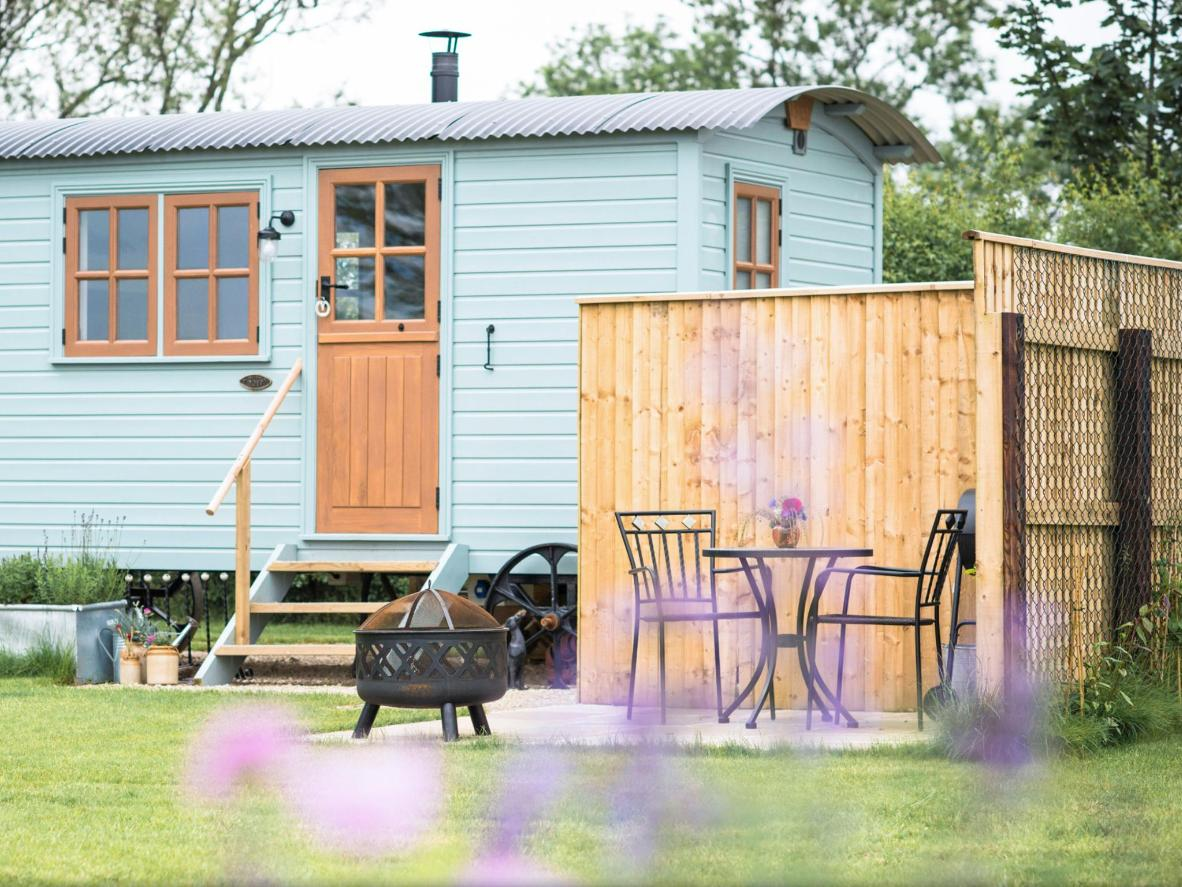 Book a painted wooden caravan with a barbecue and firepit in Yorkshire