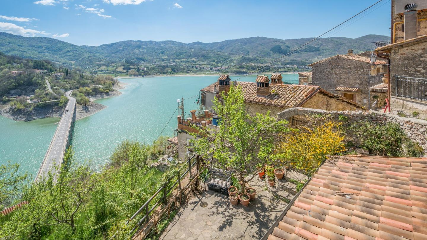 Have an antipasti lunch with a view of terracotta rooftops and the turquoise Lago del Turano