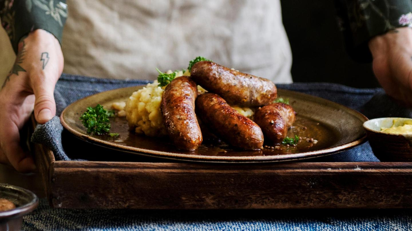 Try a classic and comforting dish of 'bangers and mash'
